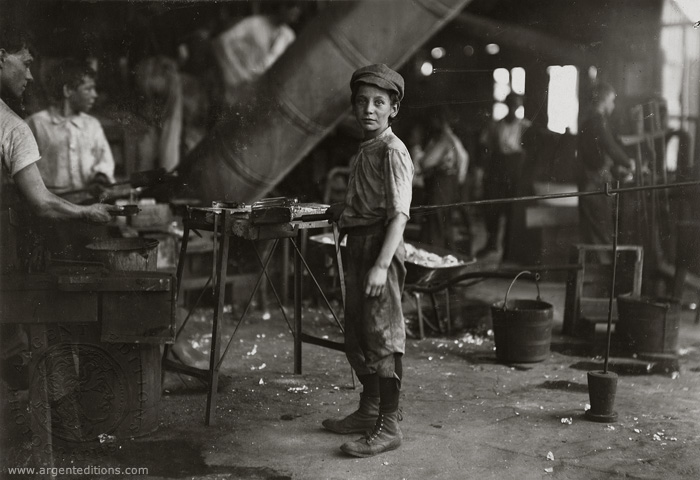 Turn of the Century boy in a factory
